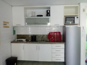 A kitchen or kitchenette at Ancorar Flat 5312
