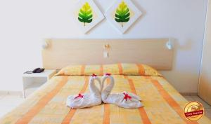 A bed or beds in a room at Terrazzo Flat Hotel JD