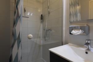 Een badkamer bij Hermes Appartementen