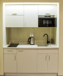 Кухня или мини-кухня в Апартаменты Малон