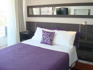Cama o camas de una habitación en Brizen Apartments - Manuel Montt