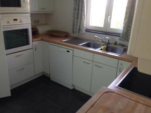 A kitchen or kitchenette at Villa Sint Anna