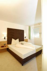 Ein Bett oder Betten in einem Zimmer der Unterkunft Residence Remi