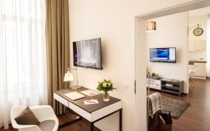 A television and/or entertainment center at Boardinghouse Luise 5