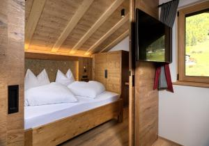 Ein Bett oder Betten in einem Zimmer der Unterkunft Apartments Riega