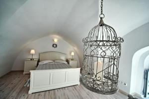 A bed or beds in a room at Archontiko Santorini