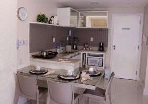 A kitchen or kitchenette at Ondina Apart Hotel - Apto. 537