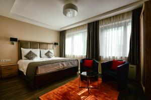 A bed or beds in a room at Cherry Apartments, Palace Quarter