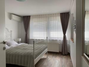 Un ou plusieurs lits dans un hébergement de l'établissement Apartments Vila Cvetka Bled