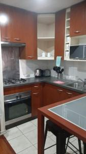 Una cocina o zona de cocina en America Departamentos