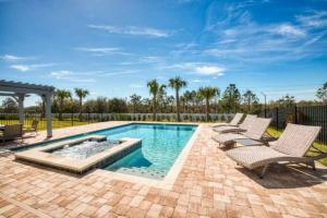 The swimming pool at or close to 9 Bd Luxury Villa 10 min from Disney Orlando