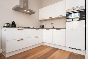 A kitchen or kitchenette at Cityden Residences Museum District