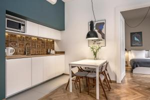 Kuchyňa alebo kuchynka v ubytovaní Relaks Apartamenty