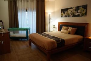 A bed or beds in a room at Machado Santos - T1 Apartment