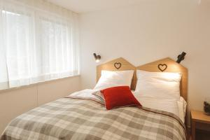 A bed or beds in a room at Apartments and Rooms Kaja