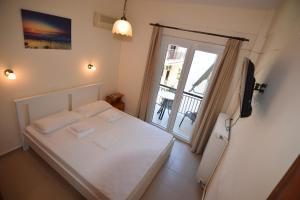 Ένα ή περισσότερα κρεβάτια σε δωμάτιο στο Jimmy's Apartments