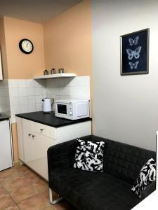 A kitchen or kitchenette at Studios du Rempart