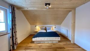 Ein Bett oder Betten in einem Zimmer der Unterkunft Haus Akelei
