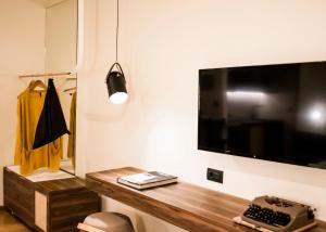 A television and/or entertainment center at GAIA, live the local way