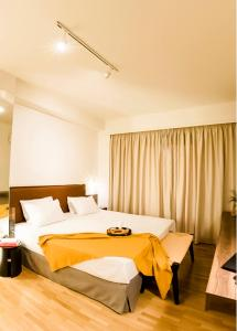 A bed or beds in a room at GAIA, live the local way
