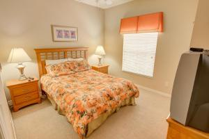 A bed or beds in a room at Coral Cay by Florida Star Vacations