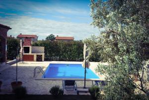 The swimming pool at or close to Villa Stella