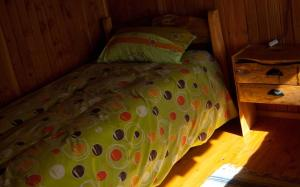 A bed or beds in a room at Cabañas Kalfvgen