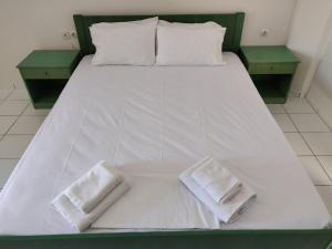 Ένα ή περισσότερα κρεβάτια σε δωμάτιο στο Viglia Beach Apartments