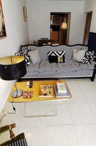 A bed or beds in a room at Amazing apartment in the heart of Athens