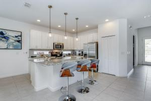 A kitchen or kitchenette at Bella Vida Resort 5 Bedroom Vacation Home with Pool 1870
