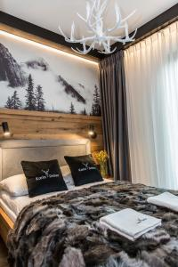 A bed or beds in a room at APARTHOTEL ROYAL RESORT SPA Zakopane