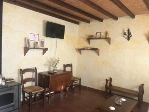 Una televisión o centro de entretenimiento en Cortijo La Ajedrea