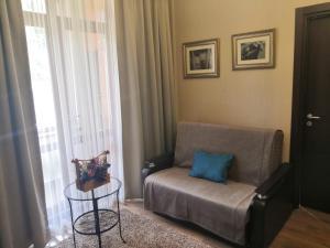 A seating area at Апартаменты Горная карусель Красная поляна
