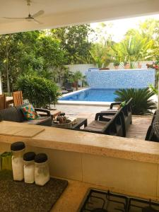 The swimming pool at or near Residence Robinson Tulum