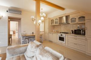 A kitchen or kitchenette at Apart39 on Okruzhnaya 4