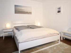 A bed or beds in a room at Apartmenthaus in der Arnoldstraße