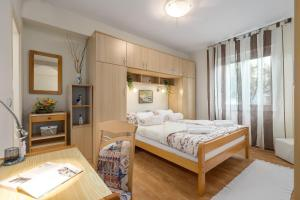 A bed or beds in a room at Apartments Nono