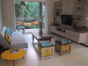 A seating area at Bangalô Villas do Pratagy
