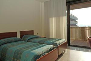 Letto o letti in una camera di Apartments Rho Fiera