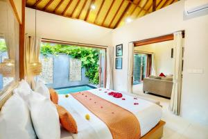 A bed or beds in a room at Legian Kriyamaha Villa