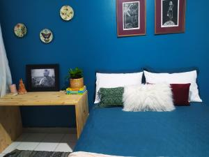 A bed or beds in a room at Aconchego na Barra