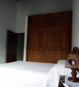 A bed or beds in a room at El Amanecer