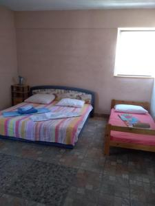 A bed or beds in a room at Apartment Bušljeta