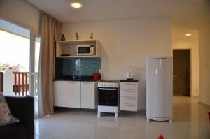 A kitchen or kitchenette at Oásis do Sol