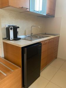 A kitchen or kitchenette at Vergos Hotel