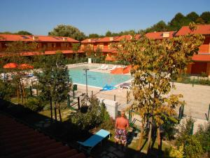 A view of the pool at Villaggio Tamerici or nearby