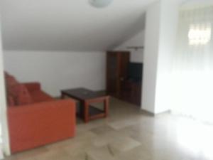 A seating area at Apartamentos Aixa II