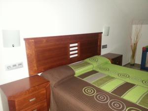 A bed or beds in a room at Apartamentos Aixa II