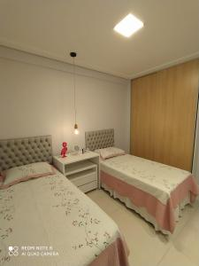A bed or beds in a room at Apartamento Camarote