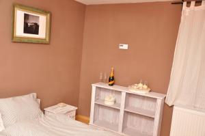 Postel nebo postele na pokoji v ubytování Patina House